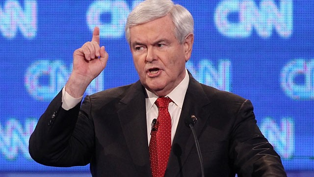 Newt Gingrich points up to the moon
