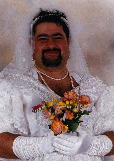 Bearded man in wedding gown